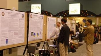 CNS researcher Eric Hazzard with his poster at Experimental Biology.