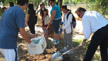 High school students and a program coordinator helped prepare soil for future planting in a CNS educational garden