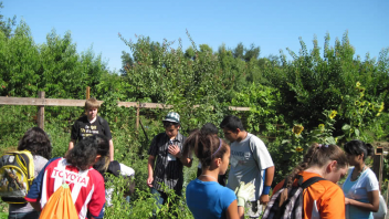 High school students learned about the different plants that are growing in an educational garden