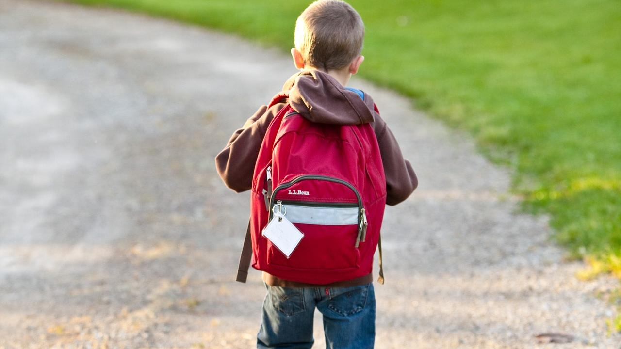 boy walking with backpack