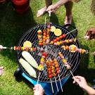 people grilling around a barbecue