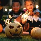 children with craved pumpkins and sparklers