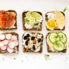 slices of bread topped with various fruit and vegetable toppings